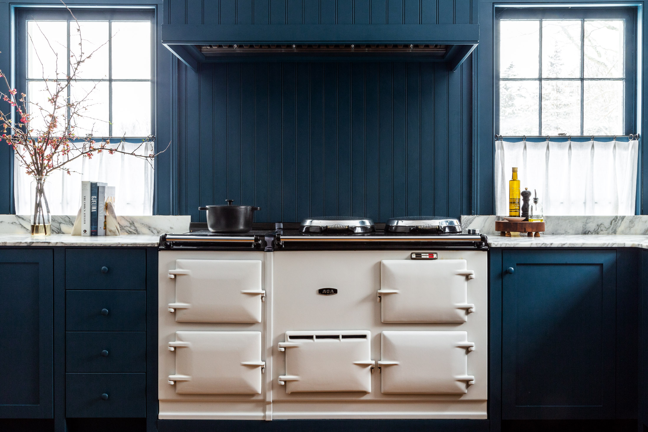 the white aga stove stands out against a sea of blue. photograph by thomas rich 10