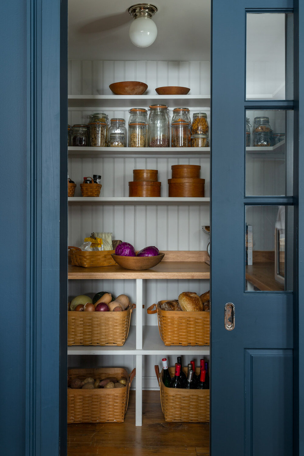 a simple shaker pantry equipped with wicker basket storage. photograph by thoma 11