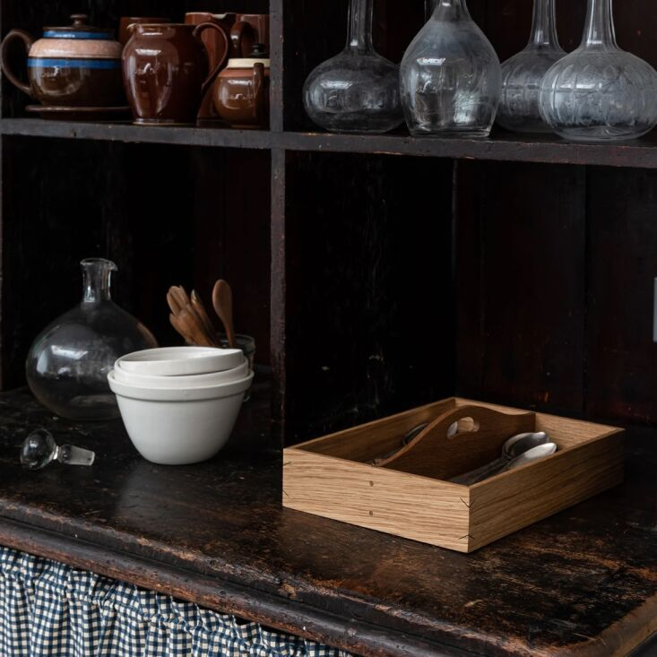 the oak cutlery tray, £\1\25, is designed to be carried to the table. it&# 16