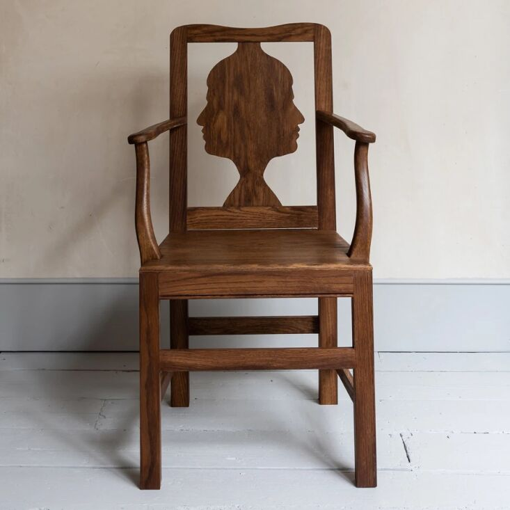 the oak silhouette dining chair, £\1,4\25 with arms, £\1,\200 without, has a  18