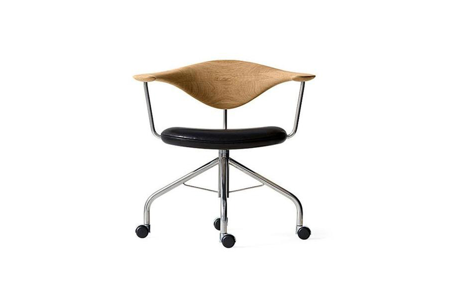 in the office, hamilton sourced a vintage version of the hans wegner swivel cha 16