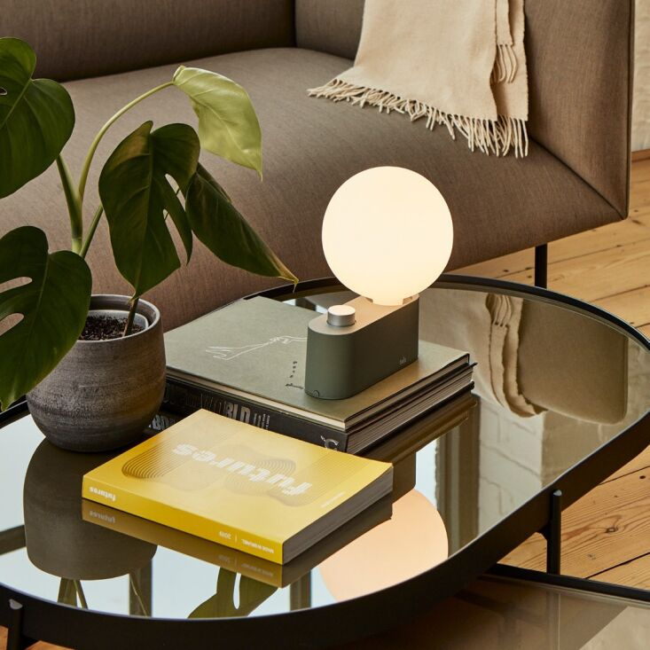 above: the alumina table lamp by tala is fully portable and comes in five finis 12
