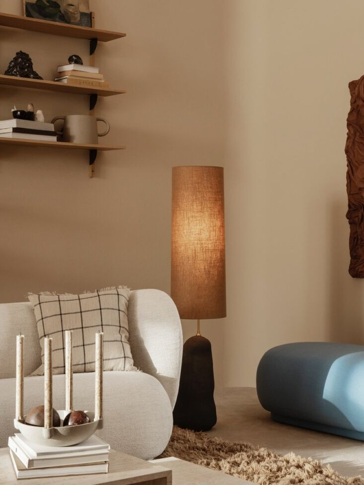 ferm living's tall, hand sculpted hebe large table lamp offers a play on scal 11