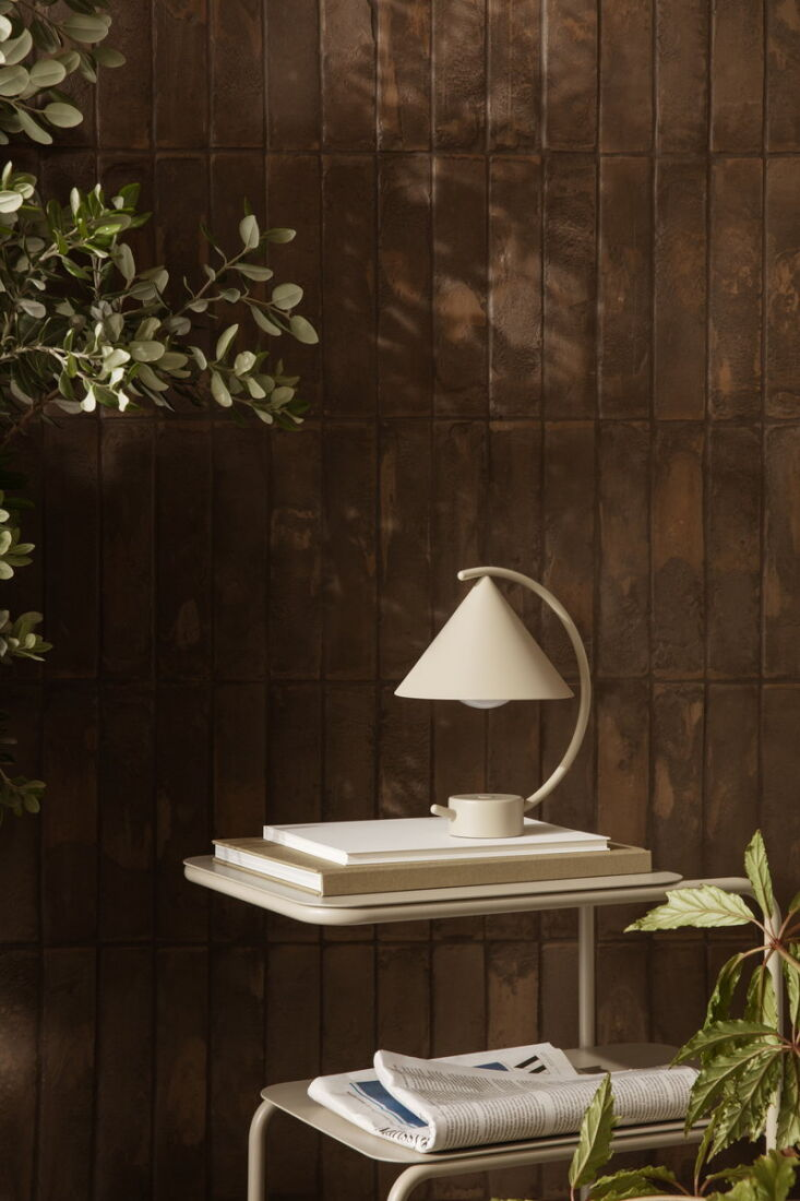 the petite, geometric meridian portable table lamp, also by ferm living, is ava 13