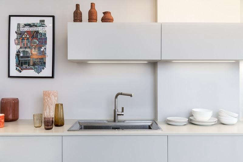 A glass fronted streamlined galley kitchen portrait 3 9