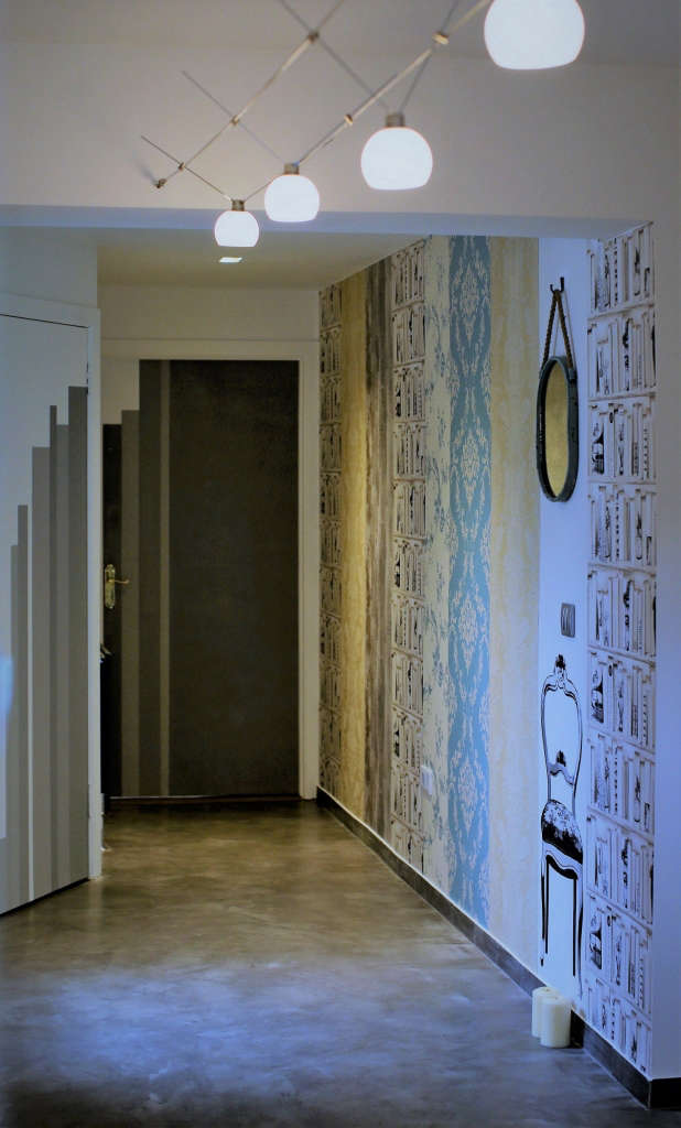 hall. wallpaper collage. recycled mirror. string lights. hand painted doors. 14