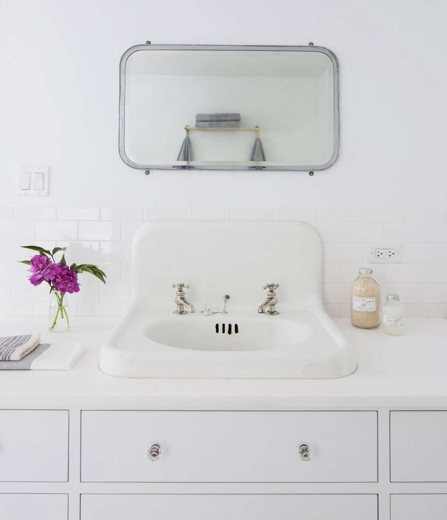 detail: vintage sink and mirror with custom vanity 12