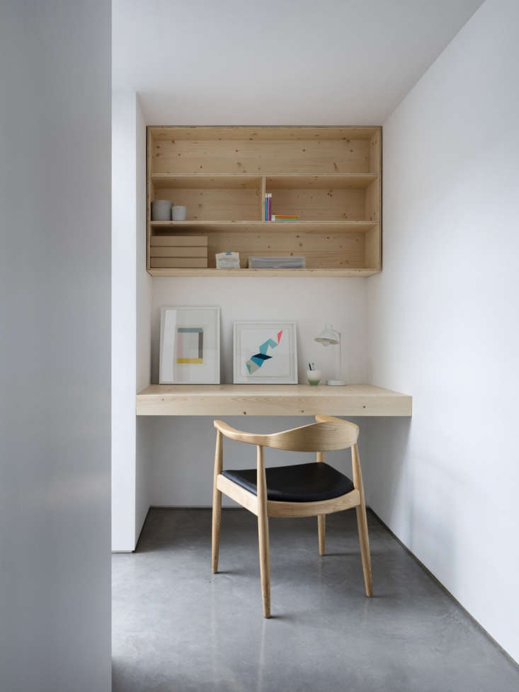 this floating desk and shelving were designed by paper house projects in the uk 9