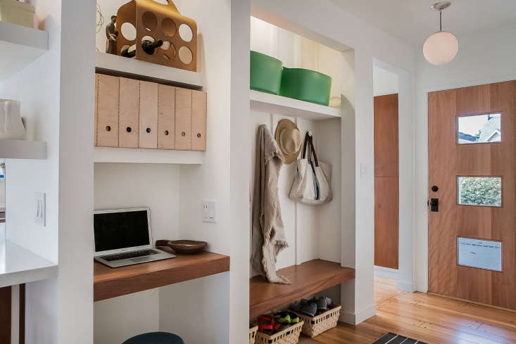 a built in desk in an entryway designed by arte berry cooke design. photograph  14