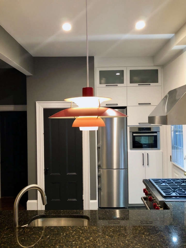 view into kitchen with ph5 pendant as center piece over island. 9