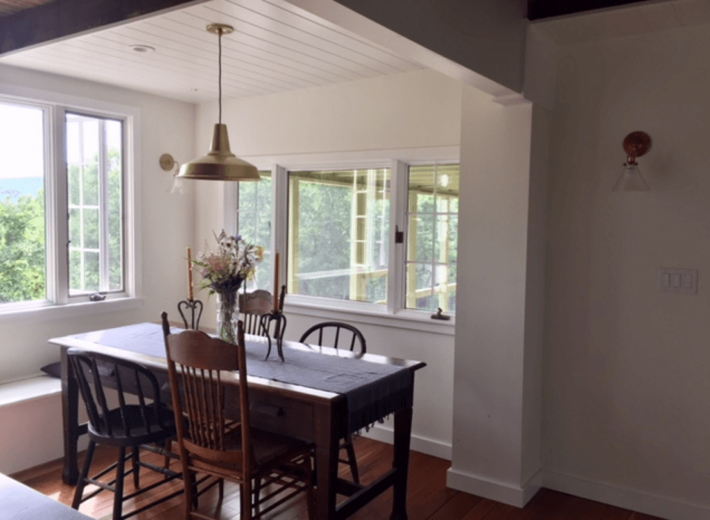 our dining room is perched between our kitchen island and the screened in porch. 12