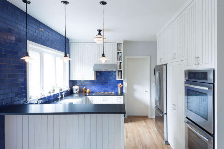 In the remodel of this U-shaped kitchen in Portland, Oregon,Opal Blue Tiles by Heath Ceramics create a bold backdrop. Architect Michael Howells of Howells Architecture & Designoffers his insight on the essentials for a successful remodel in Rehab Diaries: An Oregon Kitchen with a Dose of Downton Abbey. Photography by Anna M. Campbell.