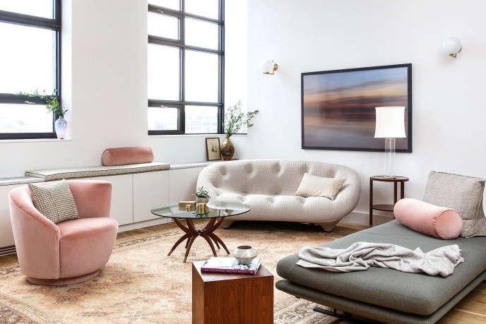 Indigo & Ochre Design Brooklyn Bridge Park loft living room w/ vintage oushak rug & ligne roset sofas
