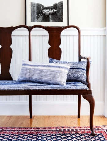 Indigo & Ochre Design Waltham Massachusetts entry foyer with antique bench upholstered in vintage hmong indigo hemp